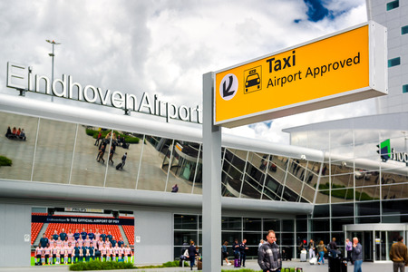 eindhoven: Eindhoven, Netherlands- May 26, 2015: Crowd of people in the Eindhoven airport. The airport is used by both civilian and military traffic. Netherlands