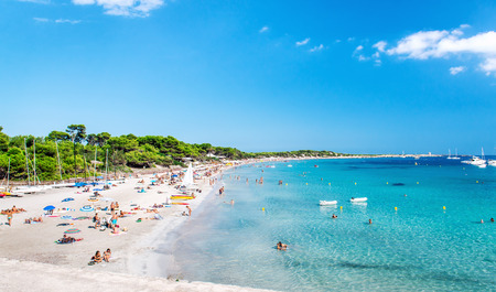 blue lagoon: Ibiza, Spain- September 21, 2013: People swimming and sunbathing on the picturesque Las Salinas beach. Ibiza, Balearic islands. Spain