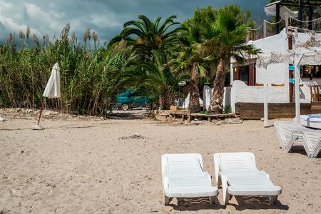 Deckchairs on the nudist wild beach. Ibiza. Balearic Islands, Spain
