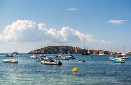 sailingboat: Motor boats at blue lagoon. Ibiza, Balearic islands. Spain