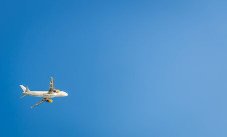 Airplane in the blue sky. Departure from Ibiza airport