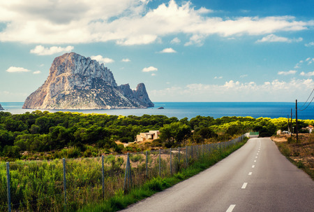 vedra: Road to the Cala dHort beach. Cala dHort is a small, beloved beach with a fantastic view of the mysterious island of Es Vedra. Ibiza, Balearic Islands. Spain Stock Photo