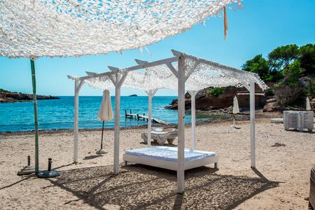 nudist: Outdoor canopy. Ibiza nudist beach. Balearic Islands. Spain Stock Photo