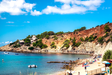 the bay: People relaxing on the Cala dHort beach. Ibiza. Balearic Islands. Spain