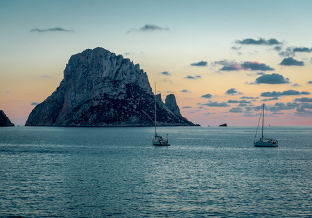 vedra: Picturesque sunset over mysterious island of Es Vedra. Ibiza, Balearic Islands. Spain