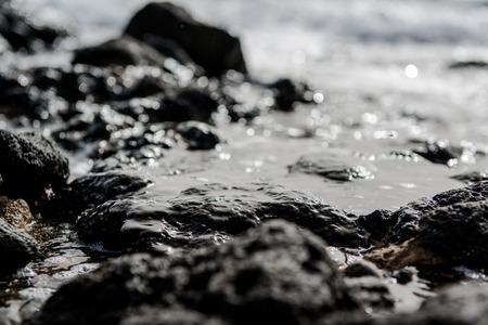 volcanic stones: Rocky coast of Tenerife. Black volcanic stones. Canary Islands. Spain