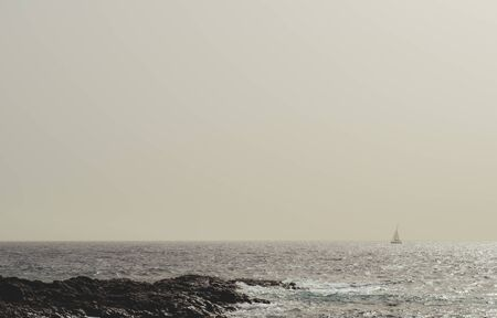 foggy: Silhouette of a sailing ship in the Atlantic ocean. Foggy weather. Tenerife, Canary Islands. Spain Stock Photo