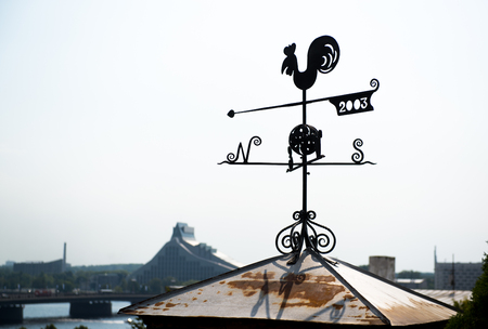 weather: Rooster weather vane in Riga, Latvia. Northern Europe