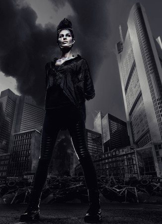 industrial ruins: Woman standing against skyscrapers and city ruins