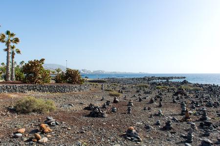 adeje: Art of stone balance, piles of stones on the beach. Costa Adeje in Tenerife, Canary Islands. Spain