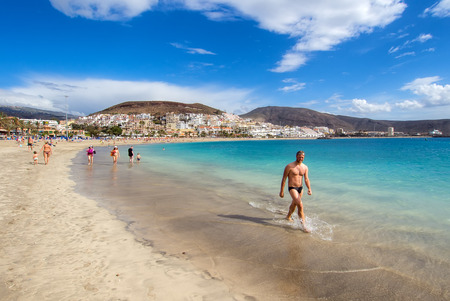 the americas: Tenerife, Canary Islands - January 09, 2015: People relaxing on the Las Americas beach, one of the most popular and well-known resorts in Tenerife. Canary islands, Spain