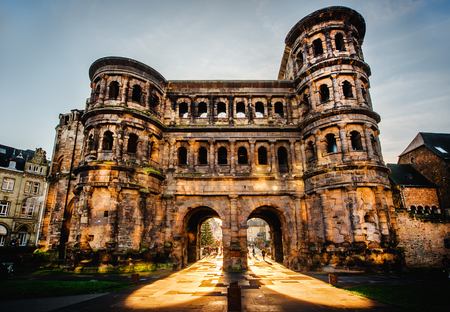 The Porta Nigra Black Gate in Trier city, Germany. It is a famous large Roman city gate. Front view.