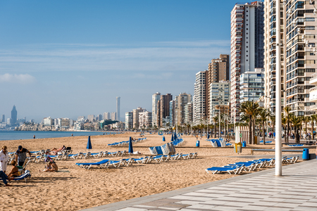 promenade: Benidorm, Spain - December 20, 2015: Beach of Benidorm. Benidorm is a coastal city in Alicante. Benidorm also known Beniyork because of the skyscrapers is a major beach destination for European tourism. Spain