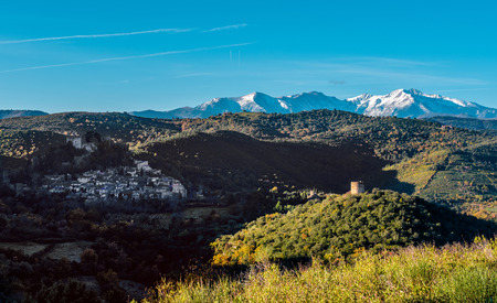 commune: View to the Castelnou village and surrounding countryside, it is a commune in the Pyrenees-Orientales department in southern France. This place classified as one of the most beautiful villages in France