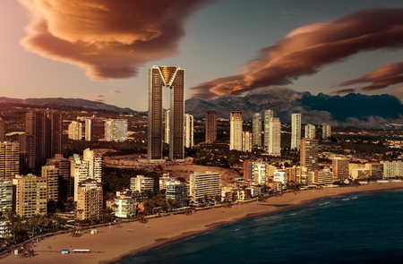 sunset city: Sunset over Benidorm city. Benidorm is a modern resort city, one of the most popular travel destinations in Spain. Costa Blanca, Alicante Stock Photo