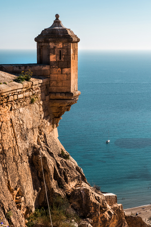 turret: Turret and the Mediterranean Sea. Mount Benacantil and Castle of Santa Barbara in Alicante city. Spain Editorial