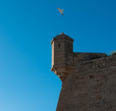 turret: Turret against blue sky background. Castle of Santa Barbara in Alicante city. Spain