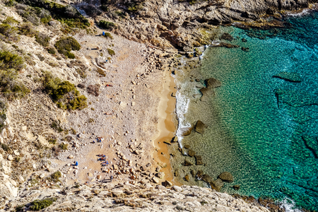 nudist: Picturesque small cove and lagoon of Cala Tao Ximo Beach in Benidorm city, view from the top. Cala Tao Ximo Beach is a popular destination for nudists. Costa Blanca. Spain
