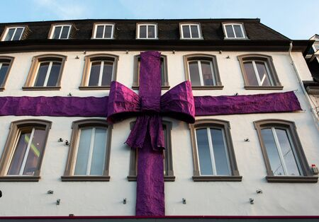 violet residential: Violet huge ribbon on a building facade. Christmas time.