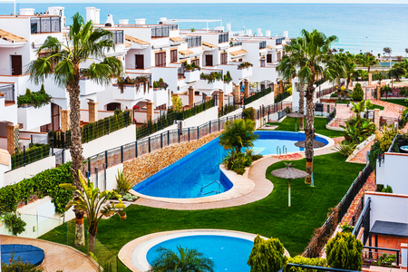 Typical spanish townhouse with a swimming pool near the sea. Alicante province, Spain Stock Photo