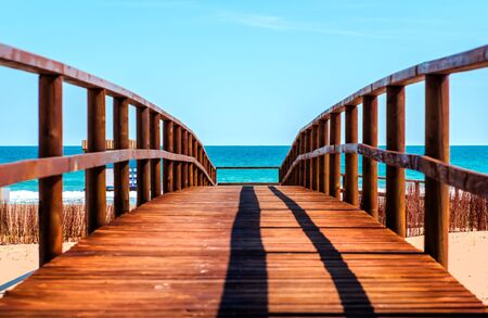 costa blanca: Wooden boardwalk to the beach. Idyllic scene