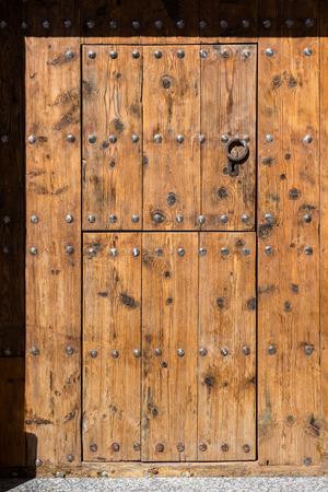 architectural exteriors: Ancient wooden door with metal handle