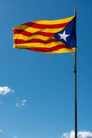 separatist: Waving flag of Catalonia (Blue estelada) over blue sky background