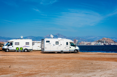 recreational vehicle: Alicante, Spain- March 1, 2016: Recreational vehicle station on the beach near Alicante city. Spain