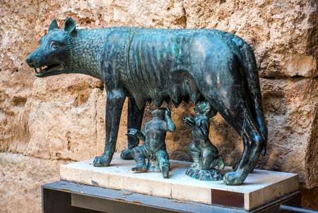 legend: The Capitoline Wolf. Bronze sculpture of a she-wolf suckling twin human infants, inspired by the legend of the founding of Rome. National Archaeological Museum of Tarragona. Spain