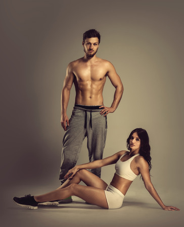 woman muscle: Young athletic man and woman Stock Photo