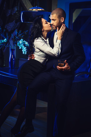 office romance: Couple indoors. Sensual brunette and handsome businessman. Office romance concept Stock Photo