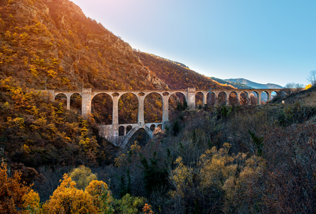 southern: Bridge in the French Pyrenees and picturesque view of mountain range Stock Photo