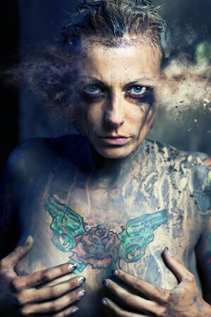 Woman with many tattoos. Digitally generated image photo