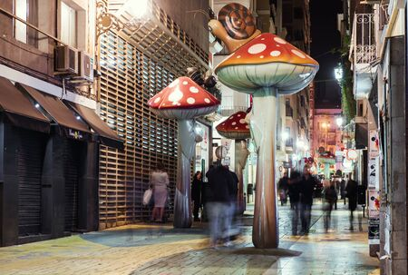 giant mushroom: Alicante, Spain-February 24, 2016: People walking on the street filled with giant mushrooms, ants and snails. Alicante, Costa Blanca. Valencian Community, Spain Editorial