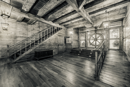 Interior of old pirate ship. Black and white image
