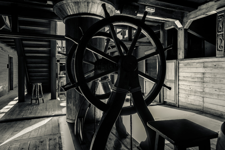 deck: Interior of old pirate ship. Black and white image