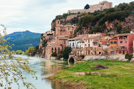 ebro: Miravet village and Ebro river. Province of Tarragona. Spain. Miravet is one of the most charming village in Catalonia Stock Photo