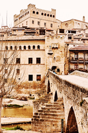 14th century: Castle from the 14th century and bridge of San Roque in Valderrobres town. Province of Teruel, Spain Stock Photo