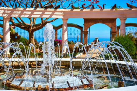 garden fountain: Fountain in the Marina dOr garden. Oropesa del Mar resort town. Spain Editorial