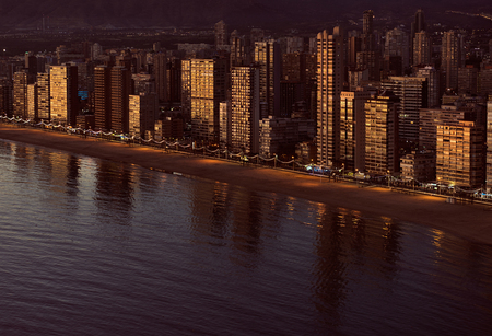 view on sea: Aerial view of a Benidorm coastline. Costa Blanca, Spain. Golden hour.