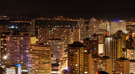 costa blanca: Illuminated skyscrapers of a Benidorm city at night. Costa Blanca, Alicante province. Spain Stock Photo