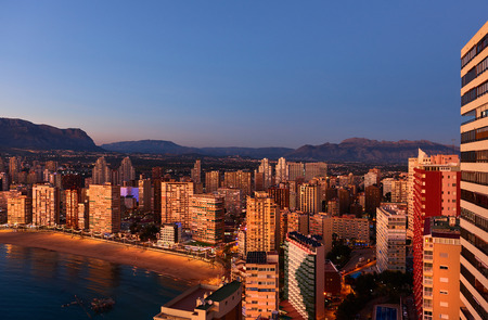 sunset city: Aerial view of a Benidorm city coastline at sunset. Benidorm is a modern resort city, one of the most popular travel destinations in Spain. Costa Blanca, Alicante province