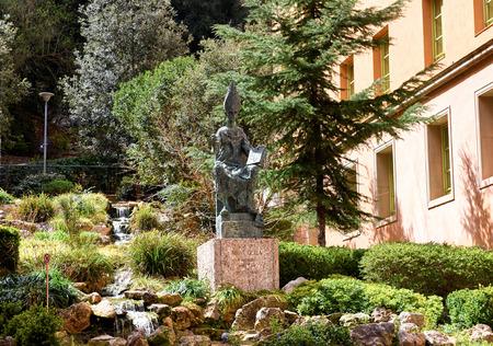 the founder: Montserrat, Spain - April 06, 2016: Statue of Abbot Oliba at Montserrat. Abbot Oliba founded the monastery of Santa Maria de Montserrat and was Spiritual founder of Catalonia. Spain