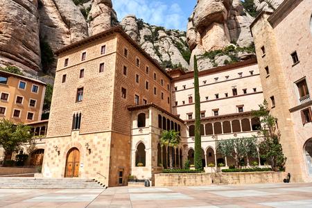 Main square of Santa Maria de Montserrat and Montserrat mountains, near Barcelona. Spain