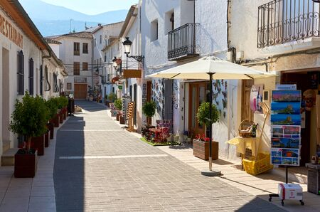 costa blanca: Guadalest, Spain- February 2, 2016: Charming narrow street with souvenir shops of a Guadalest. Guadalest is a small village on the Costa Blanca, the most visited village in Spain
