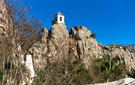 Bell tower on a rock of Guadalest. Guadalest is a small village on the Costa Blanca. Guadalest has been declared a Monument of Historical and Artistic Value and is a major tourist attraction in Spain