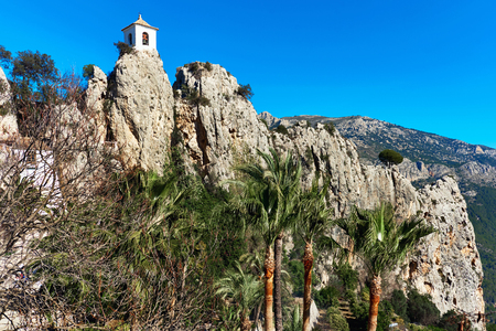 monument historical monument: Bell tower on a rock of Guadalest. Guadalest is a small village on the Costa Blanca. Guadalest has been declared a Monument of Historical and Artistic Value and is a major tourist attraction in Spain
