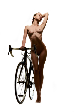 naked woman: Naked woman with a bicycle. Studio shot, isolated on a white background