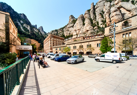 Montserrat, Spain - April 6, 2016: Spectacular Montserrat mountains and Benedictine monastery of Santa Maria de Montserrat, near Barcelona. Spain