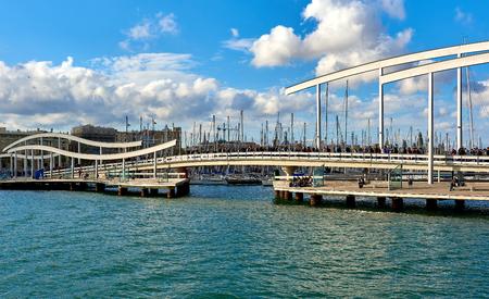 rambla: Barcelona, Spain - April 3, 2016: Rambla de Mar and Port Vell in Barcelona city. Crowd of people walking across the swing bridge on the Rambla de Mar. The Rambla del Mar is a main tourist attraction in Barcelona. Spain